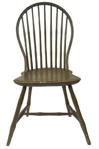 Y147 Early  19th Century nine spindle back Windsor Bow Back Side Chair,with original nutmeg paint, The mixed wood bow back Windsor side chair has a solid shaped pine seat and an ash bow back with bamboo form turned legs, it  has a nine spindled back.