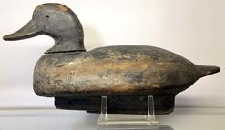 E291 Early Black Head Decoy, carver unknown. Decoy is from the Mill Creek area in Anne Arundel County, MD � just north of the Severn River. The �C� brand on the bottom stands for �Cantler� � which represents the family who owned the decoy rig. This is an outstanding decoy Circa 1920�s.