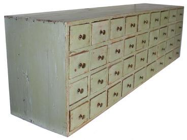 "C482 19th century  New England Apothecary with apple green paint,  Mid 19th  with  Thirty-six dovetailed drawers , with square head nail case, circa 1850  Measurements are:  14""high . 48.5""wide. 10""deep."