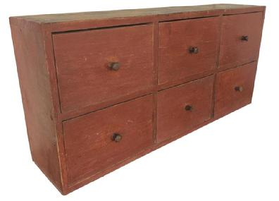 "A458 Early 19th century  Virginia  Apothecary,(1800 -1820)  with original red paint ,  dovetailed  drawers , and  case, the wood is southern heart pine, walnut drawer fronts, one board construction including the back,  held in place with rose head  square head nails. measurements are: 45"" wide x 21"" tall x 10 1/2"" deep"
