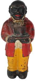 C607 Uncle Moses, cast iron bank, with Top Hat, 11 inch A cast iron Uncle Moses black man bank, figure holding top hat and wearing red coat and yellow trousers, coin slot in back circa 1890 -1930