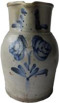 B283 One gallon cobalt decorated stoneware pitcher Baltimore Maryland origin,Peter Herman maker stamped. circa 1870 decorated with brushed cobalt flowers on front, the collar decorated with swag's on each side of spout.