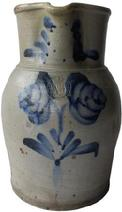 "B283 One gallon cobalt decorated stoneware pitcher Baltimore Maryland origin,Peter Herman maker stamped. circa 1870 decorated with brushed cobalt flowers on front, the collar decorated with swag's on each side of spout.  measurements : 10"" tall 6 1/2"""" diameter"