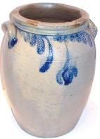 Unsigned approximate 13 5/8 tall crock with blue leaf floral decoration,all around.