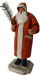 This traditionally stern faced, blue eyed, Belsnickle Santa has been handcrafted by the renowned doll-artist Kathy Patterson.