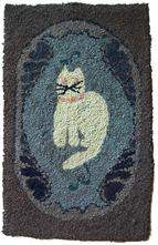 "American, late 19th-early 20th century, wool on burlap. White cat with with pink collar, sitting alertly within an oval border. 38"" high x 23.5"".w"