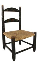 "B493 Mid 19th century Ladder back Child's Chair with the original black paint, decorated with flowers, original rush seat , Measurements are 9"" wide x 8"" deep x 14 1/2"" tall"