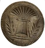 "E21 19th Century very deeply carved wooden butter stamp with a large Sheaf of Wheat, 2 branches with leaves and a Pie Crust Rim.  NOTE: In early Christian paintings, a single sheaf of wheat represents harvest and fertility.     			Measurements: 4 1/4"" Diameter x 3� tall"