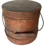 "**SOLD** RM1076 Rare Small Shaker Bail-Handle Sugar Bucket, Firkin, Red Paint, Circa 1860 - 1880 As depicted, tapered sides, staved construction with wire and turned wood bail handle, three single finger bands and sheet iron diamond shaped escutcheon plates. Wonderful dry red painted surface    Measurements:  5 3/4"" tall, Diameter is 6 3/8"" (bottom) and 5 7/8"" (top)"