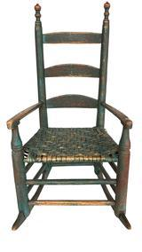RM1122 Sensational 18th Century New England Child�s Rocking Chair in wonderful original green paint. Rocker features original woven seat and the detailed arms and steam-curved slats are all wooden peg construction. There is spectacular wear to the backs of the intricately turned finials