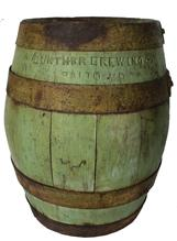 B287 Late 19th century Wooden Beer Keg from  The Gunther Brewing Company  O'Donnell Street in Baltimore, Maryland. with old green paint  the bands are  held in place with iron bands , very tight stamped on the bottom and sides Gunter Brewing Co. Baltimore Md.  circa 1890 -1900.