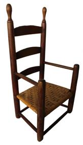 "B583  18th century rare example Child's Chair having  elongated finials above three arched slats, , the arms are simple  rods.  Maple and ash retaining an old red painted surface. New England.  Circa 1790 -1820  H. 25 1/2"",  13 1/2"" wide"