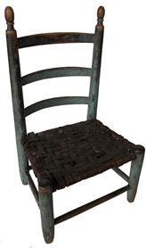 "D549 18th century Child's ladder back Chair. in early blue paint. over the original black paint, with three bowed hickory slats mortised and pegged into egg finial topped back, with strretcher base and early woven ash splint set  10 1/2"" X 8 1/4"" X 17 3/4"""
