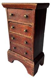 "F212 Rare Southern diminutive tall four drawer Chest circa 1790-1800 ,in original red decorated paint, the wood is yellow pine , with a applied boot jack cut out base. The drawers are tee nailed construction, the drawer divider are mortised into the sides. The surface on this little chest is outstanding 8"" wide x 4 1/2 "" deep x 14"" tall"