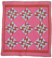 X469Late 19th century  Drunkard�s path crib quilt ca. 1880; pieced printed cotton with machine quilting and white cotton back, 36 ¾�x 40�