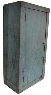 "C45 Early 19th century  Hanging Cupboard  from Maine  with the original dry  blue paint,  the wood is pine, square nail construction, one board door with two applied baton on inside of door circa 1820 -1840  Measurements are: 12 1/2"" deep x 23 1/4"" wide 42"" wide"