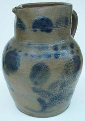 "U229 Half gallon cobalt decorated, Stoneware Pitcher, ovoid Pitcher with tooled collared mid section decorated with flower and leaves, circa 1850 measurement are: 9"" tall"
