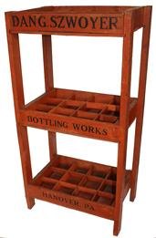 D163 Early 20th century bottle rack with great bittersweet red paint with black letting. This rack was used in a store to sell ginger ale for Dang Szwoyer Hanover Pa