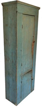 "D412 Mid 19th century  Pennsylvania two door  painted pine chimney cupboard, retaining  original blue surface, the doors are a single board with two batons attaching to the back of the door. The case has 3/8 bead around opening, with a small cove molding at the top, all square head ail construction, two board back circa 1840 Measurements are  79"" high , 27 1/2"" wide , 13 1/2"" diameter"