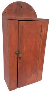 C421 19th century Pennsylvania single door  Hanging Cupboard with dry red paint, with a high  tombstone back board with hole for hanging, all square head nail construction