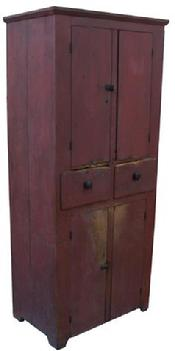 X498 Early 19th century Pennslyvania  four door Storage Cupboard, with two tall center drawers, square head nailed, with original red paint, the doors are single plank doors, with scratch beading around door opening, all original hardware, with a chamfer top molding around the case.