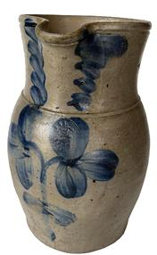 F159  One Gallon Cobalt Decorated Stoneware Pitcher, stamped �P. Herrmann�.  (Peter Herrmann / Baltimore Potter /1825- 1901)  Ovoid-bodied pitcher with tooled rim and applied strap handle decorated with a double clover and tri-leaf swags around the neck.  Brushed cobalt swags decorate each side of the spout.  Baltimore, Maryland origin. Measures 10� tall.