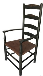 D25  Late 18th century Pennslyvania   ladder back armchair with rush seat with Five arched slats enclosed by turned stiles.shaped arms with baluster and cylinder turned supports, rush seat,with  black paint , great wear to the paint