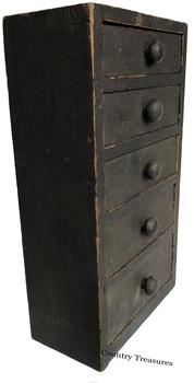 "D509 Early 19th century hanging five graduating drawer  Apothecary ,early black paint over the original bittersweet , the drawers are dovetailed, original knobs, the drawer dividers are dovetailed into the case circa 1830 Measurements are:12"" wide x 21"" tall x 6"" deep"