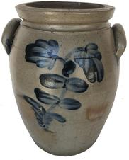 "E243 STAMPED ""P. HERRMANN."", BALTIMORE, MARYLAND DECORATED STONEWARE JAR, salt-glazed, ""3"" gallon capacity mark, semi-ovoid form with squared rim, beaded neck ring, incised shoulder ring, and arched handles. Brushed cobalt floral decoration to each side, additional cobalt at handle terminals. The pottery of Peter Herrmann (1825-1901), Baltimore, MD. Circa 1875. 13 1/8"" H, 7 3/4"" D rim."