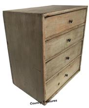 "D262 19th century Painted pine stack of  drawers , with four drawers, nail construction,   retaining an old gray surface.  Measurements are 19"" wide x 12"" deep x 21"" tall"