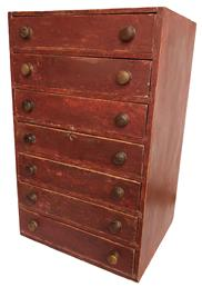 C550 19th century New England Set of seven graduated drawers, in the original red paint, the drawers are dovetailed and well as the case with the original knobs beautiful back