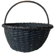 E512  Gathering Basket ,  the original dark indigo blue paint, with a double wrapped rim, steamed and bent handle, and a slight raised bottom.