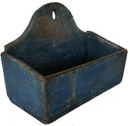 "D99 Early 19th century hanging  Wall Box,from Pennslyvania, in the original blue paint,  dovetailed case, tombstone shape back., with hole for hanging wonderful dry surface with great wear to the interior, this wall box was used for a long period of time for a silverwear box, sjowing the wear to the interior. 12"" wide x 9"" tall x 5 3/4"" deep"
