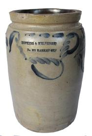 "B385  Philadelphia Advertising Jar attributed to the Remmey Pottery, Philadelphia, PA, circa 1870. It has  straight-sides, Impressed with the advertising ""HOPKINS & M'ELVENEY. / No. 612 MARKET ST."" Advertising is highlighted in cobalt and surrounded by cobalt brushwork"