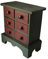 "B305 Mid  19th century New England  ( Maine) six drawer Spice Chest with the original red and green paint , wonderful size, dovetailed drawers front and back, applied high bracket base, drop apron, the case is  square nail construction, all original circa 1840-1850 Measurements are  13 3/4"" wide x 7 1/8""  x 15"" tall"