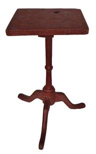 C66 18th century New England  Candle Stand in original dry red paint  paint, the top is one board , the wood is walnut , The delicate square  top is held in place with tee nails , that receives the graceful baluster turned pedestal on a tripod cabriole legs ending in slipper feet with full pads circa  1790