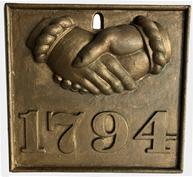 E396 A heavy cast iron fire mark with clasped hands and �1794� in relief in later gold gilt paint.