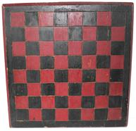 "B340 Late 19th century Game Board , with the original red and black paint, one board white pine construction, with a champfered edge, each block on the Game Board is deep scribed, to make each block stand out. carved on  the back are the initials (C.C. H.) Measurements are: 14"" x14"""
