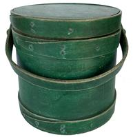 "F237 19th century  New England original dry green  painted  Wooden Firkin, tongue and groove softwood staved sides, tapered lap joint wood bands, bent wood handle with wood peg attachments Painted pine firkin, 9 3/4"" across the bottom x 9 1/2"" tall x  9"" across the top"