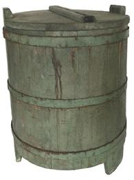 D441 19tn century Pennslyvania Country Store Barrel, resting on three legs with original lid which is dovetaild on one side to lock it in place . It retains early green paint, tongue and groove softwood staved sides, Tapered lap joint,with three hand made iron bands,