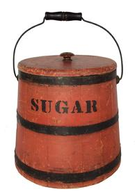 "A357  19th century Covered Sugar Firkin with old red paint, staves sides  with black painted bands, lid with wooden  knob, wire bail swing handle with handle grip. With SUGAR painted on the side 11"" tall x 11"" across the bottom and 9"" at the top"