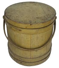 "C42 Early 19th century Large  New England mustard  Covered Wooden Firkin, tongue and groove softwood staved sides, tapered lap joint wood bands, held in place with rose held nails  this Firkins  bent wood handle with wood peg attachments,14"" high . 14 "" diameter and bottom  14 3/4"""