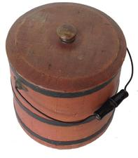 "P728  SUGAR BUCKET. American, 2nd half-19th century. Stave construction with bentwood swing handle. Sugar Bucket with the original salmon paint and lid 13 1/2"" tall"