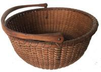 E482 Nantucket Swing Handle Lightship Basket Circa 1890Carved and notched wooden ears, turned, molded and incised bottom; tapered and chamfered oak ribs, good color
