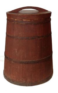 E98  Circa 1890-1900 tall tapered wooden bin with lid in wonderful original dry red paint.  Staved construction made from white pine wood with four hand wrought iron bands securing the staves in place. Lid has steamed and bent rim and applied handle. An unusual, rare, super piece!  Measures 24 3/4� tall and 20�across bottom and 15 3/4� across top.