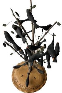 "F183 Great piece of Americana, 24 wooden hand crafted black birds, resting a on a tree, in a Pie  ""Four and twenty Black birds setting before the King Signed and dated by maker M. Dallas 91"