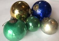 "E514 A GROUP OF FIVE KUGEL CHRISTMAS ORNAMENTS Including, silver, green,blue  and gold, with embossed brass caps, some discoloration, from 2 1/2""dia to 5""dia."