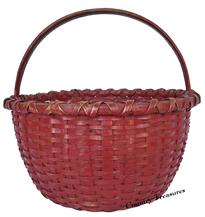 "D235 19th century beautiful red painted Basket, with a nice high steamed and bent handle, double wrapped rim with a kicked in bottom.great condition, very well made tight and sturdy. Measurements are:10"" tall  11"" diameter"