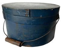 "RM1077 19th century  New England bail handle pantry box, The box retains the original lid and bail handle. Everything is sturdy and stable.The original beautiful blue paint  Measurements: 11 1/4"" diameter x 6 1/2"" tall"