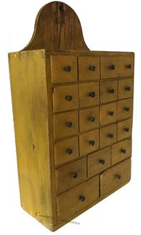 "D321 Early 19th century Pennsylvania Hanging Apothecary with twenty one dovetailed drawers, in a dovetailed case with high tome stone arch  back with hole for hanging,in the most beautiful yellow paint, all original knobs. This apothecary was used in a country store and used to sell powder paint pigments, with a yellow pine back and white pine case, most likely  was from Chester County or Lancaster County PA. Measurements are: 6 3/4"" deep x  14 1/2"" wide 23 7/8"" tall"